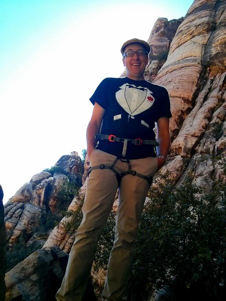 Doc wearing his wedding tuxedo tee, getting ready to climb